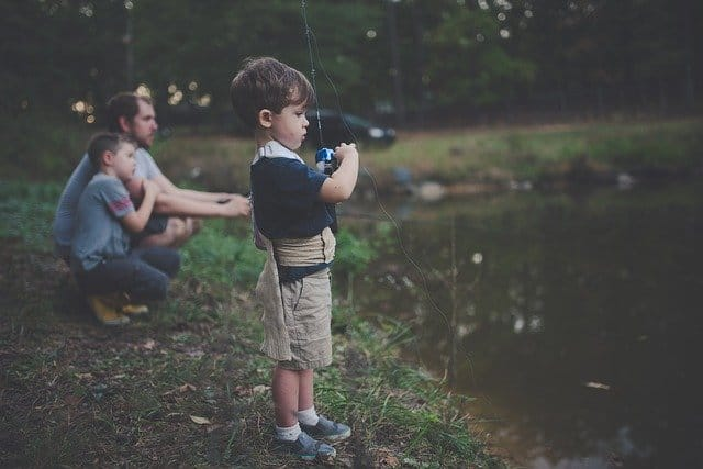 kids fishing with dad